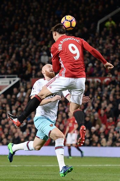 Manchester United's Swedish striker Zlatan Ibrahimovic leaps to head the ball and score their first goal to equalise 11 during the English Premier...