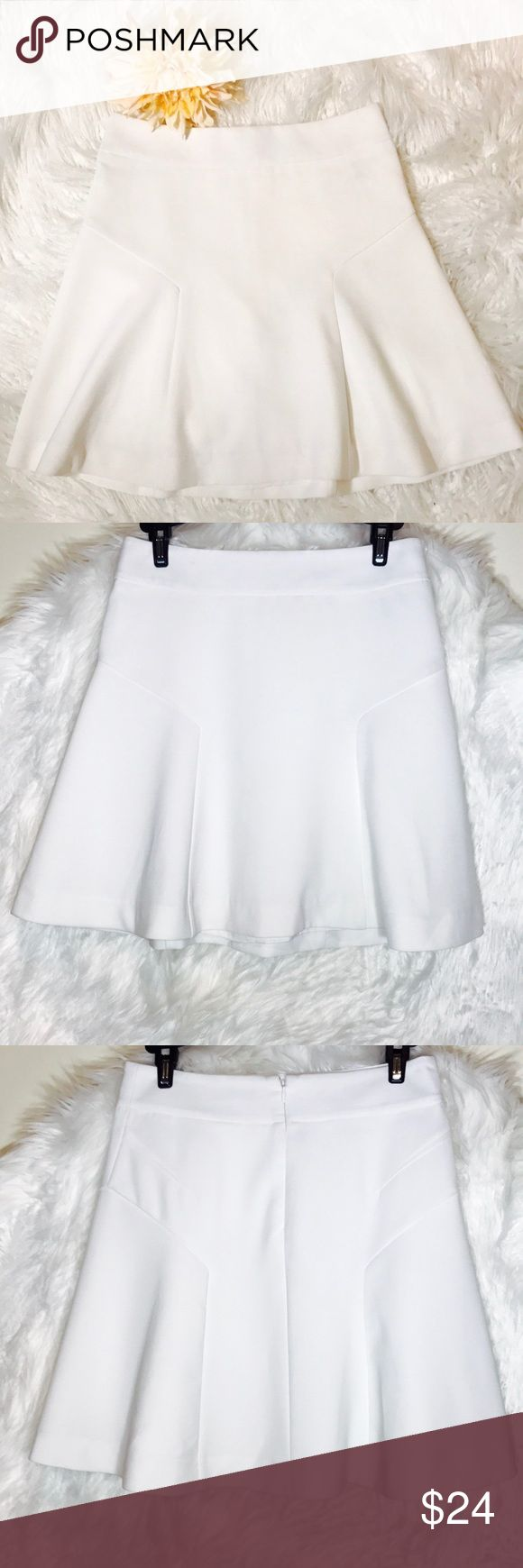 "Express White Skater Skirt A fun, feminine shape in light fabric with silky lining for anytime your feel like it. Try it with a cute lace cami when its time to party, or a soft tee for a more casual feel on the weekend. Laid flat across @ waist: 13.5"", length: 18"". NWOT Express Skirts"