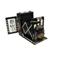 Cámara de fotos antigua decorativa en metal envejecido, con portafotos para capturar tu mejor momento! Más figuras para #decoracion #retro #vintage en www.vasderetro.com/figuras-retro/varios