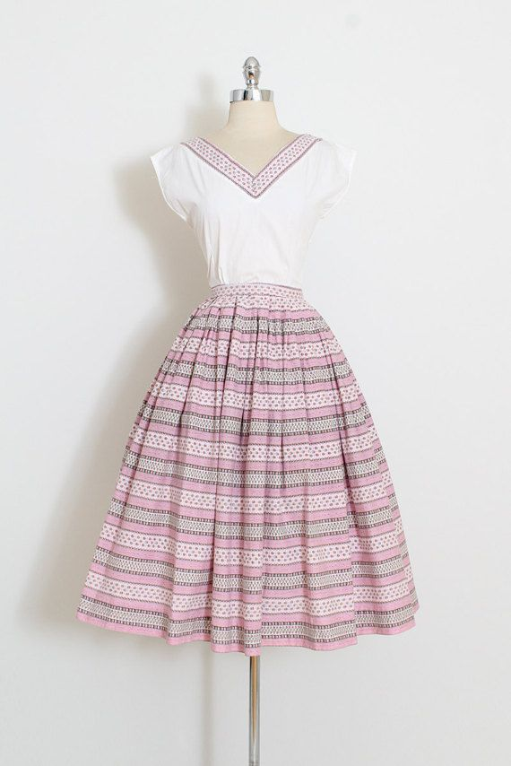 ➳ vintage 1950s skirt and top * darling pink and white cotton * floral and stripe print * metal zipper side close on both pieces condition | excellent fits like medium skirt: length 29 waist 28 hem allowance 2 top: length 22 bust 38 ➳ shop http://www.etsy.com/shop/millstreetvintage?ref=si_shop ➳ shop policies http://www.etsy.com/shop/millstreetvintage/policy twitter | MillStVintage facebook | millstreetvintage instagram | millstreetvin...