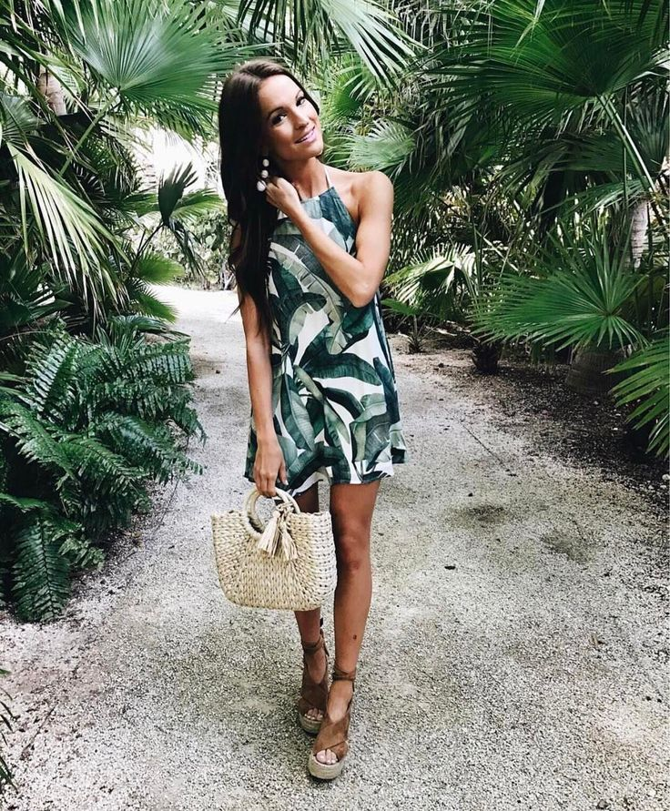 @laurenkaysims is in a palm tree paradise in the show me your mumu Katy Halter Dress