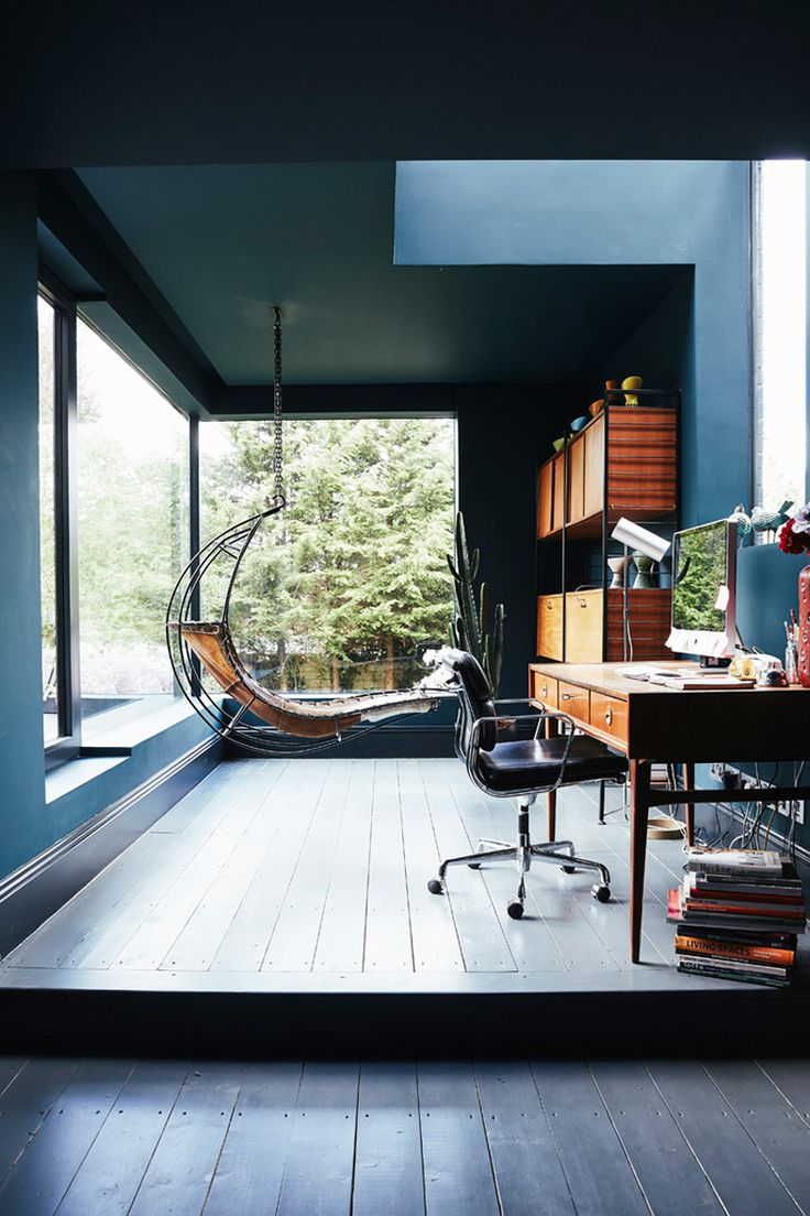 Gorgeous office blending industrial and midmod styles. Love the huge windows, midcentury-inspired desk and shelving--and of course that hanging chair!