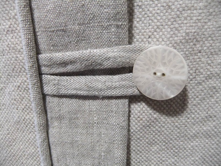 linen flap over a concealed zipper and added button tabs