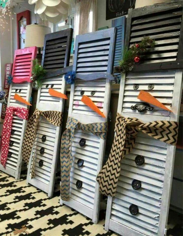 Snowman with old shutters                                                       …