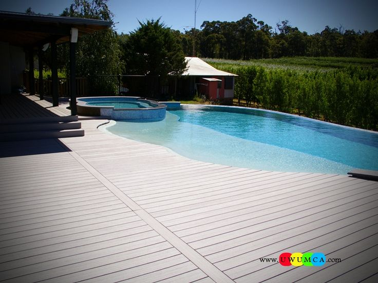 Swimming pool pool decks peerless trex decking around pools with beach entry pool design ideas - Above ground composite pool deck ...