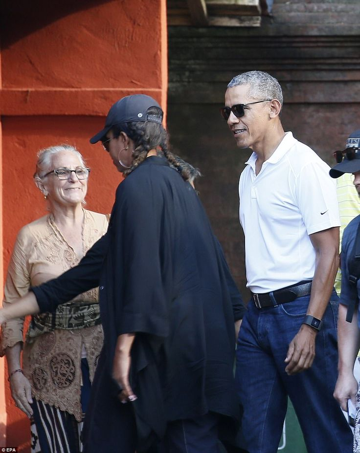 Despite the heat Mrs Obama donned a black cardigan. She eschewed a cap from an exotic loca...