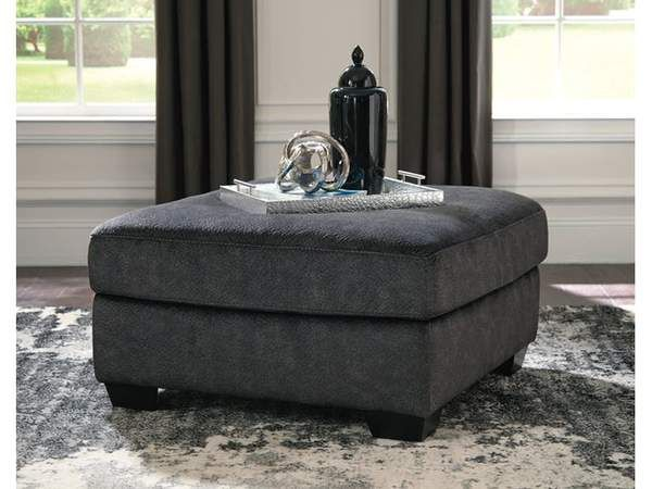 Looking for the perfect blend of decadent comfort and contemporary flair? Feast your eyes on this ottoman! Its oversized square profile definitely takes center stage. Wonderfully plush to the touch, the ottoman's granite gray fabric is the ultimate choice for a chic, trendy look.