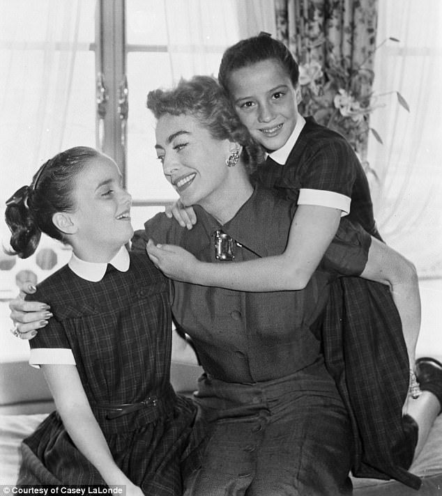 Legendary Hollywood actress Joan Crawford (pictured with her adopted twin daughters Cathy and Cindy in 1957) was redefined as a sadistic control freak by the movie Mommie Dearest – an abusive drunk who forced her children to eat raw steak, almost killed her eldest daughter and had an strange hatred for wire hangers