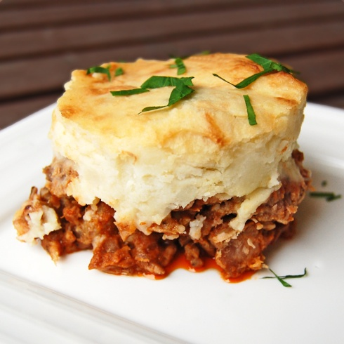 """The French equivalent of  cottage or shepherd's pie, it's named after Antoine-Augustin Parmentier, a French pharmacist, nutritionist, and inventor who, according to Wikipedia, in the late 18th century, was instrumental in the promotion of the potato as an edible crop. Hachis means chopped or minced, and comes the same root as the English word """"hatchet"""". So, lots of chopping"""