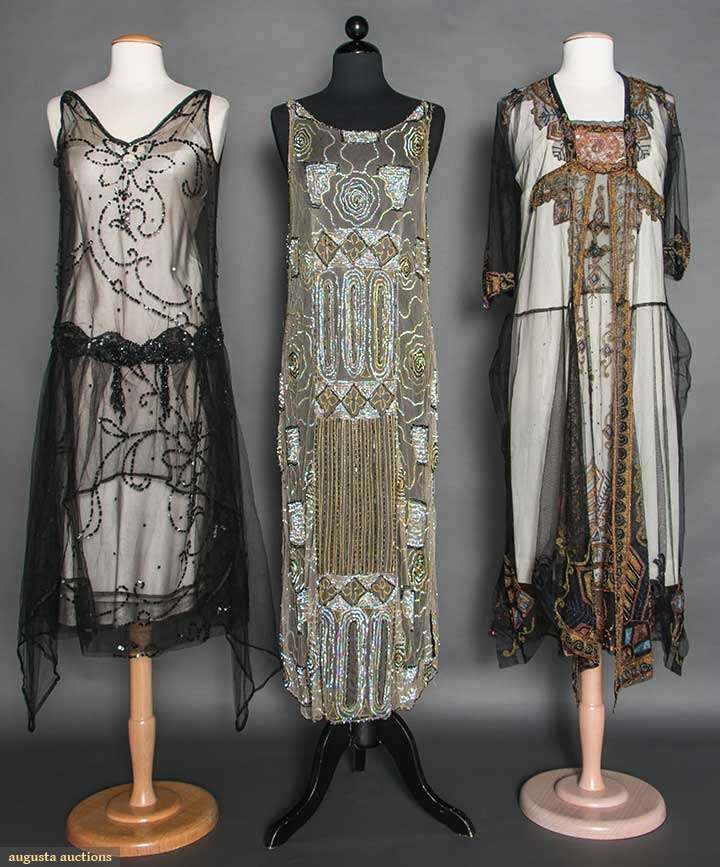 BEADED/SEQUINED DRESSES, MID 1920s 2 tabards w/ sequins: 1 black, 1 white w/ black; 1 black net w/ gold, pink & blue embroidery & beading