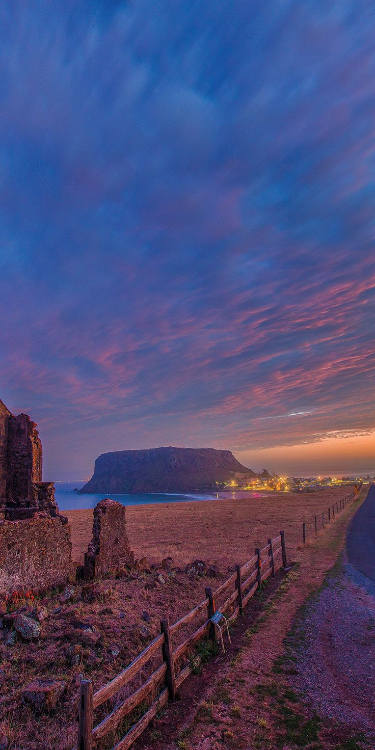 Sunset over The Nut, in Stanley - by Paul Pichugins