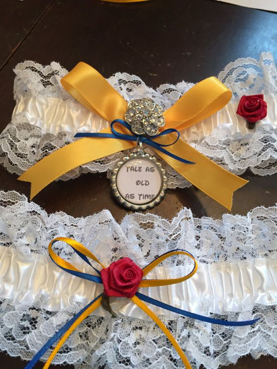Enchanting Belle Garter . Keepsake Garter decorated with ribbons, rhinestone brooch, handmade charm, and red rose. Perfect for a Disney wedding!   TOSS GARTER AVAILABLE $10