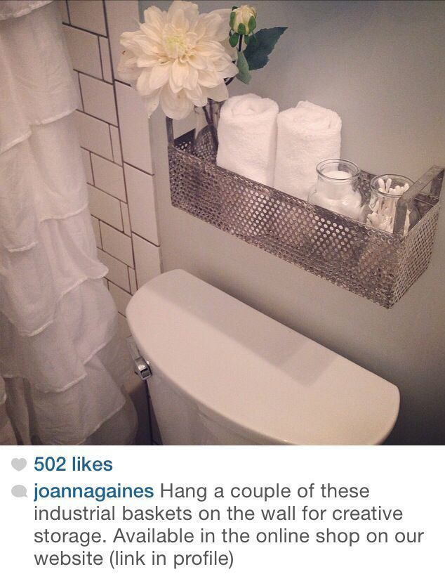 Creative Storage: industrial baskets. Im doing this!! Need a place to store toilet paper for those times my lovely husband forgets to change the roll!