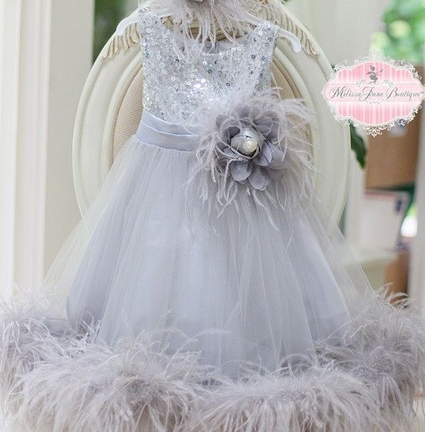 Simple Sweet Girls Ostrich Feather Dress for the Special Ocassion  Dress is made out of sequin bodice Top fully lined with zipper at the back, Overlays of mesh tulle fabric, lined with high quality Full Soft Ostrich FeathersDetacable Feather Brooch with rosette and pearl center  Sizes 2 - 14 years  Matching Headpiece extra $28.00 NOT FOR WHOLESALE Chest Sizes 1/2 years   22