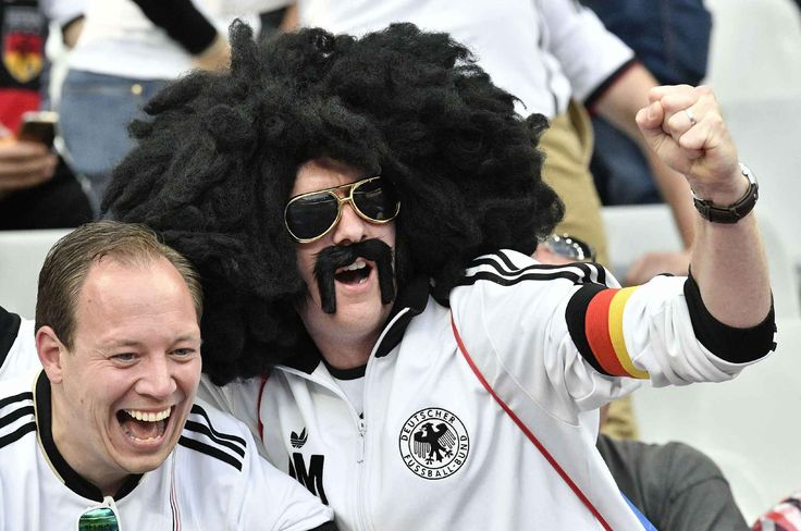 Supporters of Germany cheer on the stands prior to the Euro 2016 Group C soccer match between Germany and Poland at the Stade de France in Saint-Denis, north of Paris, France, Thursday, June 16, 2016. (AP Photo/Martin Meissner)/PW104/905966334471/1606162049