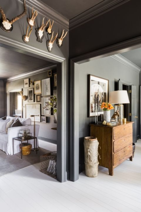 This modern country home in Memphis know how to style antique decor with a dark color palette.