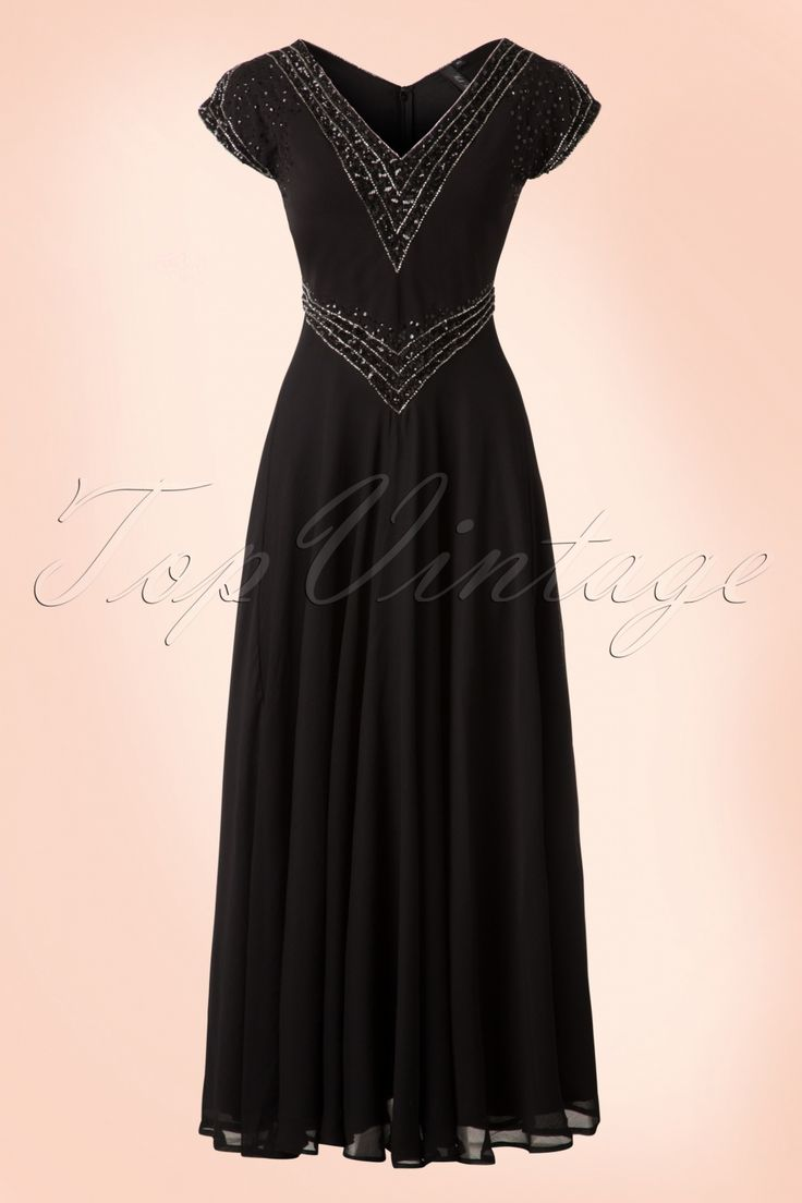 This20s Myrna Embellished Maxi Dressis a gorgeous Art-Deco inspired, 1920s style reproduction.  Glamorous and elegant, this breathtaking maxi is a real showstopper! The bodice features an elegant V at both the front and the back, stunning cap sleeves with slits and iscovered with hand beaded tiny silver toned beads and black sequins, wow!The long, flowy skirt moves gracefully with every step you take and hits the ankle. Made from a semi-transparent bla...