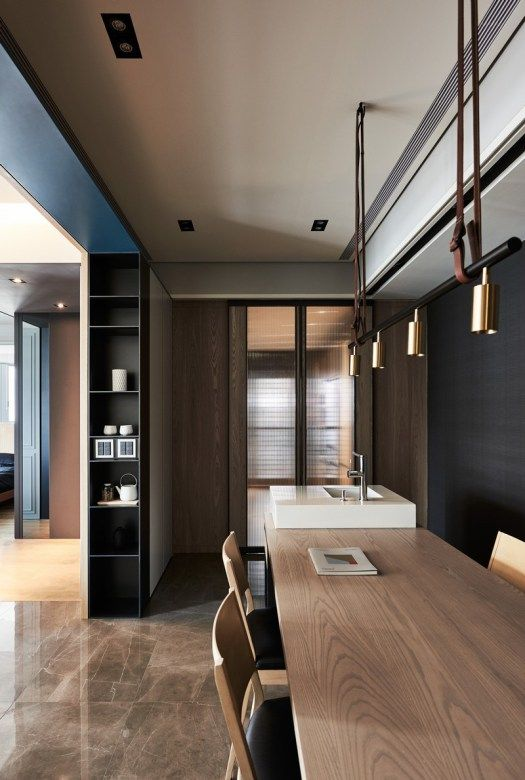 Leather hanging lighting system above dining table - Taiwan Xie Residence