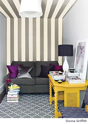 love how the ceiling stripes extend up from the wall and the rug in the same colors but a different, softer pattern...and the pop of the yellow desk and plum throw pillow