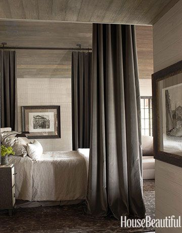 Dignified Master Bedroom Designer Susan Ferrier of McAlpine Booth & Ferrier Interiors decorated this Alabama lake house in a modern traditional style. In the formal master bedroom, Great Plains Cotton Velvet in Dusk drapes the bed; Fineline floor lamps are from Casella Lighting. Mattaliano bedside tables are cerused oak and vellum.
