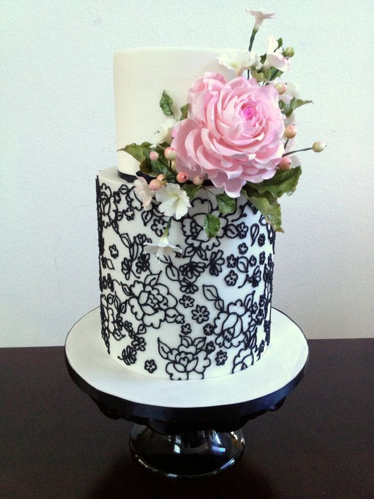 wedding cake with lace and flowers fondant wedding cake with pink spray and flower print 26909