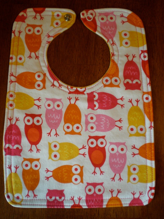 Just got for a friend's baby shower. Love them, they're so stinkin cute (and durable too)! Reversible Baby Bib  Pink Yellow and Orange Owls by PBJFabric, $10.00