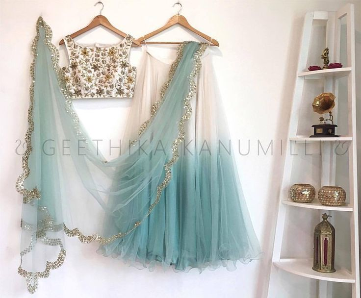 Stunning white and sky blue color lehenga and white color designer crop top with hand embroidery thread work. 30 July 2017