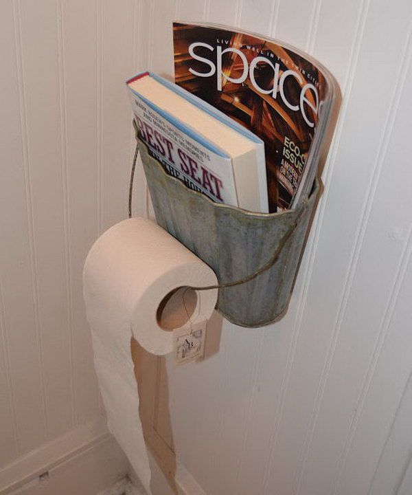 This metal basket was recycled as magazine and toilet paper holder. http://hative.com/clever-toilet-paper-storage-or-holder-ideas/