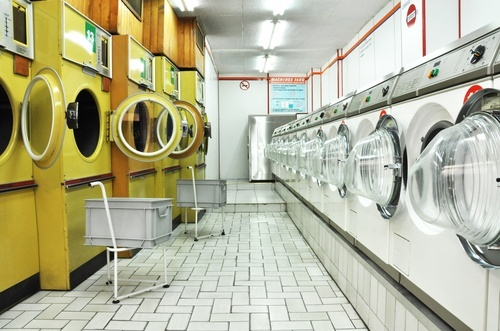 """THE LAUNDROMAT LITMUS TEST (atlantic cities): """"Most bona fide urban dwellers either have machines in the basement or they have a nearby (read: walking distance) laundromat that they can use. Yet, here in Greensboro, there are no real downtown laundries. The closest one, near a gas station, with free dryers, just happened to be out of order on Sunday."""""""