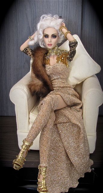 Stunning! I love all her gold attire! The makeup is striking, too. Altogether a beautiful doll.