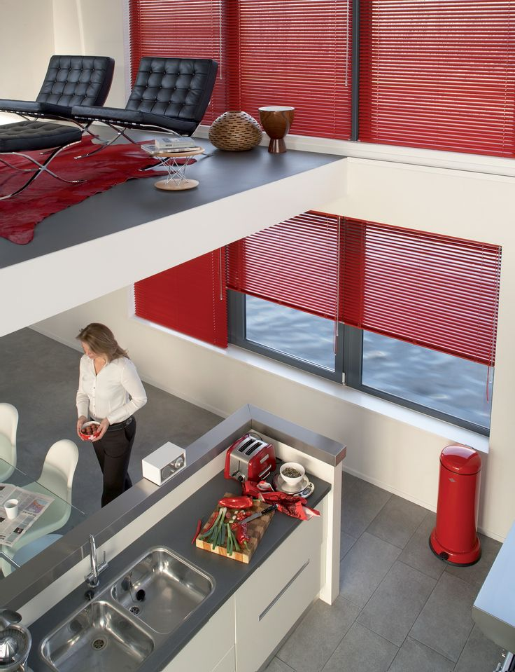 Bold red Luxaflex Venetian Blinds create a real design statement whilst creating light and privacy control.  #red #kitchen # Venetian Blinds #luxaflex