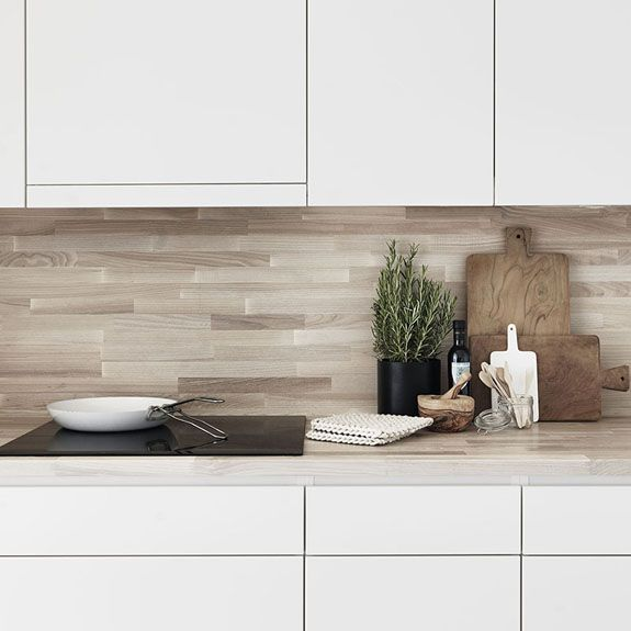 white kitchen with wood countertop + backsplash // Folkhem