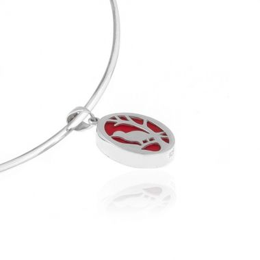 A sterling silver pendant featuring an oval shaped red coral gemstone, set in a silver design showing a bird on a branch. This modern yet romantic hand carved design is inspired by the beautiful and tranquil greek nature. A coral silver pendant, which will complement any of your casual, business, and day to night looks. Match it with elegant red coral sterling silver rings or delicate red coral 925 silver earrings to create versatile looks.