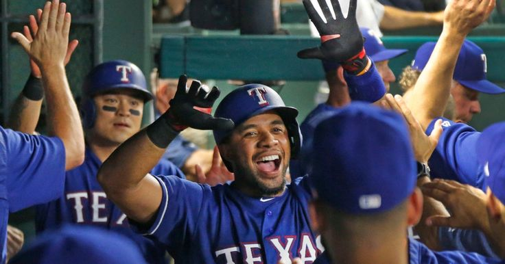 Rangers congratulate Elvis Andrus after his home run in the sixth inning against the Mariners 8-2-2017. (Louis DeLuca/The Dallas Morning News)