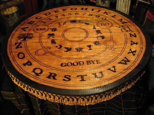 Wooden carved Ouija table.