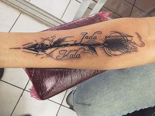 forearm name tattoo with arrow iç kol oklu isim dövmesi