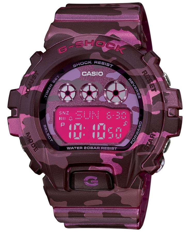 Designed for the woman with adventure in mind, this G-Shock sport watch is tough, stylish and functional. | Pink camouflage resin strap | Round case, 48x46mm | Pink digital dial with negative display,
