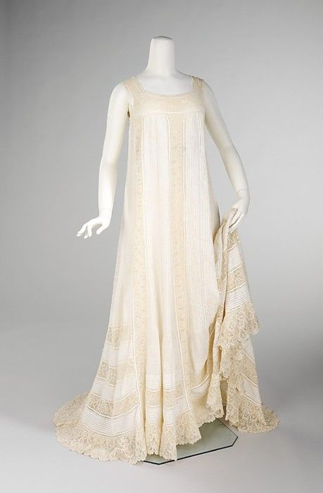 Nightgown 1905-- I like the way the strips of lace go down the front and around the bottom of the skirt