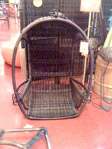 Its a hanging chair at pier1 and is so cumfy!!! it has cup holders and magazine racks!!! It was so spacious and seemed like a little hideaway spot!!! It sits on the floor or you can buy the stand and swing a little :-) I WILL have this one day lol