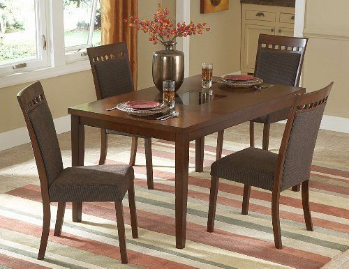 5353-60 Fleming Dining Table with Glass Insert by Home Elegance. $320.00. Dimension: 36 x 60 x 30H.. Dining Table.. Collection: Fleming.. Design is stylish and innovative. Satisfaction Ensured.. Great Gift Idea.. The contemporary lines and distinct veneer pattern of the Fleming Collection are the perfect addition to your modern space. Finished in a warm cherry, the table features a square smoked glass insert. Collection: Fleming. Dining Table. Dimension: 36 x 6...