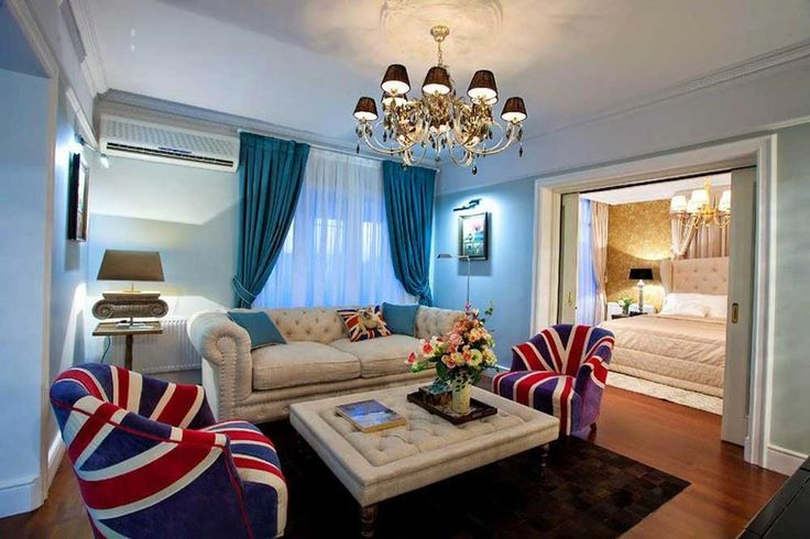 Teal Lounge Design with private lounge room decorating with England flag upholstery chair symmetry curtain design ideas