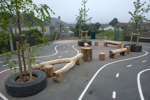 Low cost natural elements added to a basic Tarmac play space this could be what we need Playground Build & Design | Natural Child Play | Earth Wrights Ltd