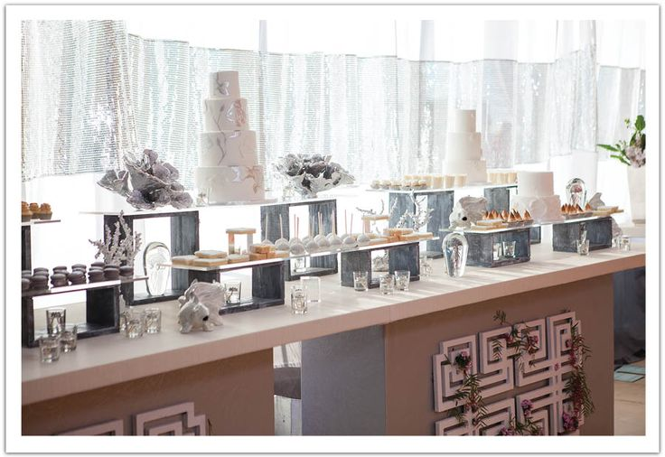 Extravagant silver & white modern 16ft dessert bar! Five wedding cakes, custom silver & white goodies from Sweet & Saucy, gourment cookie bar, espresso bar, 80s candy bar, hot fresh donut stand, Sweet Lucies vintage ice crea car and tray passed cookie and milk shots!   Wedding Event and Design by www.alchemyfineevents.com