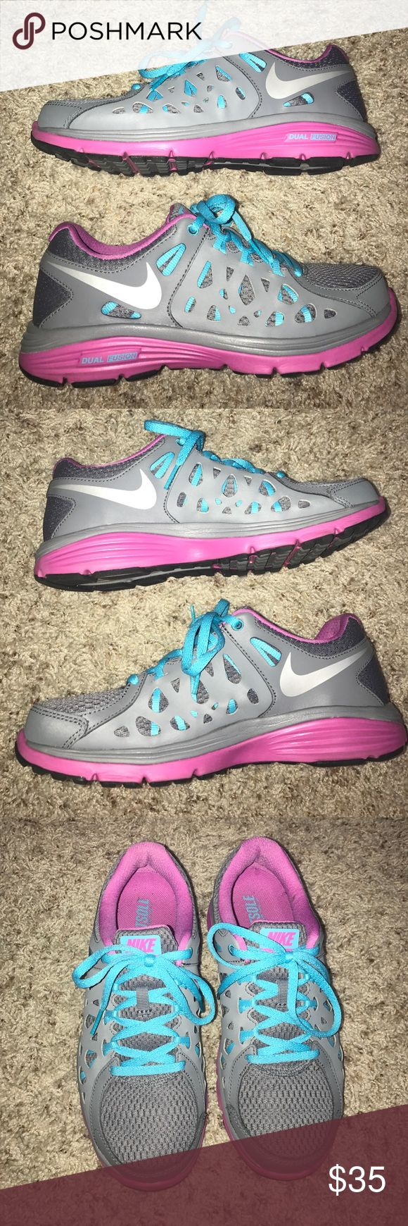 Nike Dual Fusion Run 2 Size 7.5 Women's + Nike Dual Fusion Run 2 + Women's size 7.5 + Bought in 2013   only worn a few times so in excellent condition + Colors are: Grey, Aqua and Purple + Shown with and without the flash so you can have a true idea of the colors + Smoke free and pet free home 🏡 + No trades 🚫  ✨ If you would like any additional photos or if you have any questions... please let me know! Nike Shoes Athletic Shoes