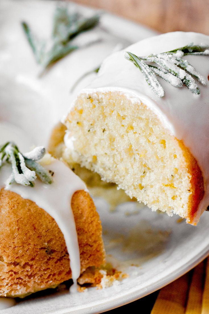NYT Cooking: This is a very light cake, similar to a lemon drizzle but with a ton more flavor. The rosemary and orange add delicious floral notes. A fluted Bundt pan looks especially nice. Prepare the crystallized rosemary sprigs at least 6 to 8 hours (or the day before) before serving the cake, which will keep in a sealed container at room temperature for up to three days.