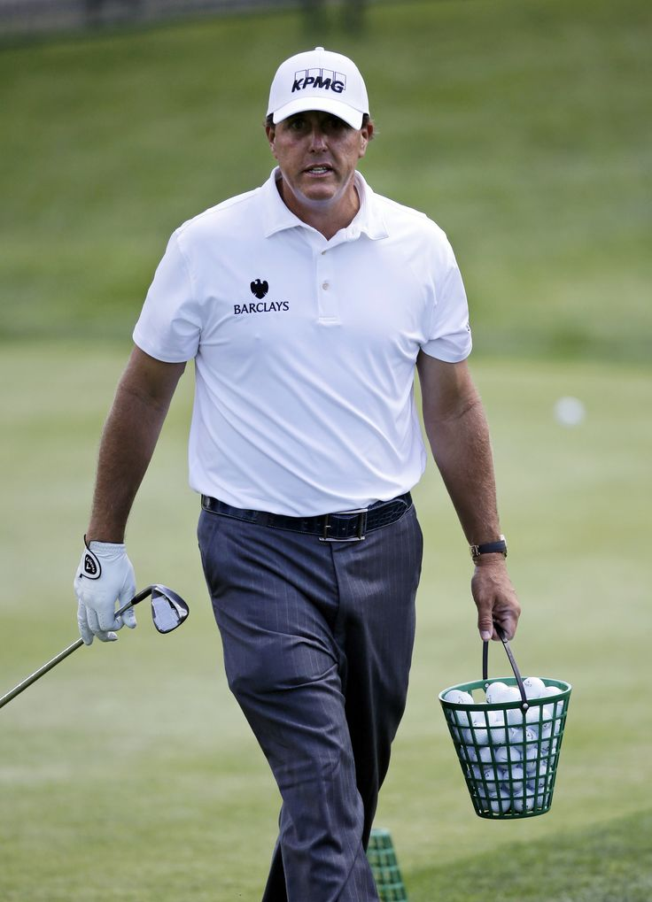 phil mickelson practice | Phil Mickelson walks on the practice range with a bucket of balls ...