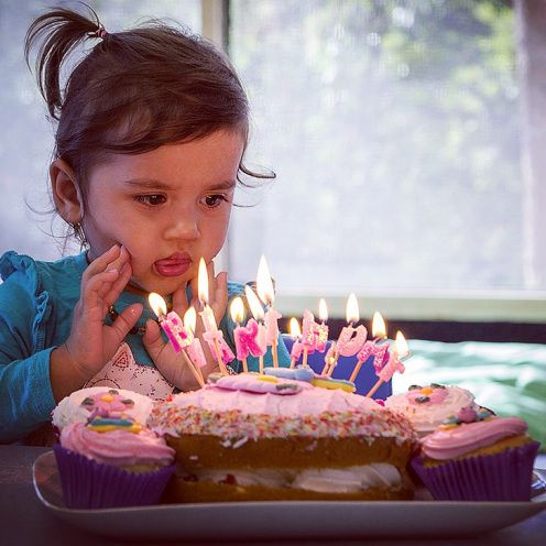 Counting my blessings after an up-and-down week - how cute is #dinobaby's little tongue as she concentrates on her candles!