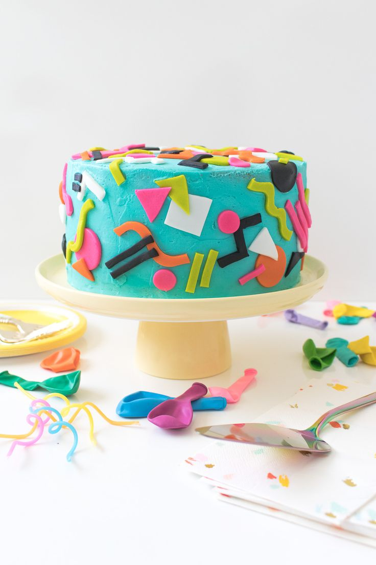Throwback! Tie dye 90s-inspired cake  with abstract patterns in colorful fondant and layers of tie dye vanilla cake