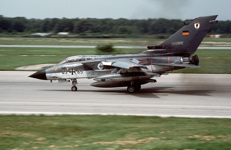 A Federal German Navy Panavia Tornado IDS aircraft (s/n 43+65) lands at Naval Air Station, Oceana, Virginia (USA), on 1 August 1989. The Tornado belonged to Marinefliegergeschwader 1 (MFG 1) (Naval Fighter Wing 1) at Jagel Air Base, Schleswig-Holstein (Germany). After the end of the cold war MFG 1 was disbanded in 1993. Note the thrust reversers.