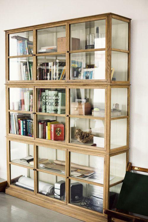 stunning glass bookcase (via Courtney Klein | annstreetstudio) - my ideal home...